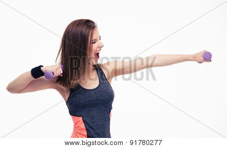 Screaming woman workout with dumbbells isolated on a white background