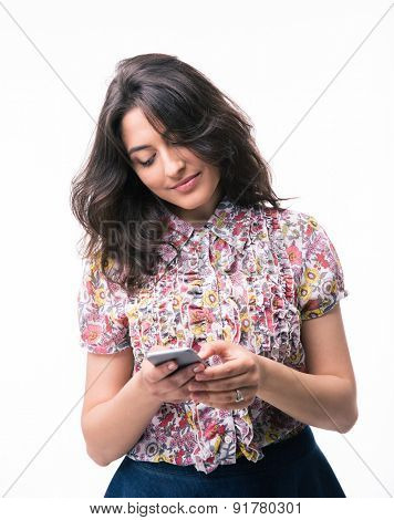 Young woman using smartphone isolated on a white background. Looking at phone