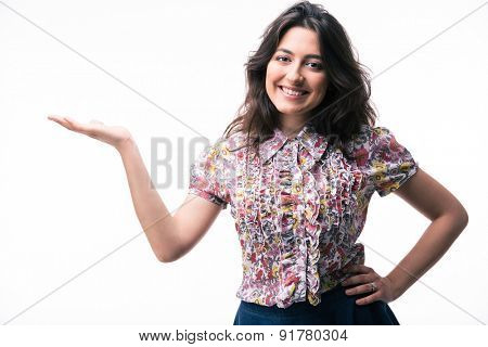Happy woman presenting copy space on her palm isolated on a white background. Looking at camera