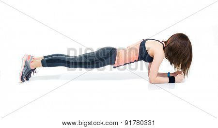 Sporty woman doing exercises on the floor isolated on a white background