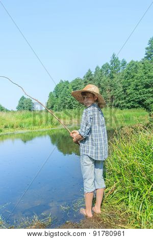 Barefoot Fishing Boy Standing In Transparent Yellowish Waterbody