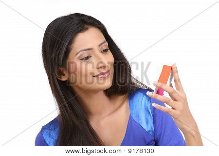 Woman looking her Credit Card