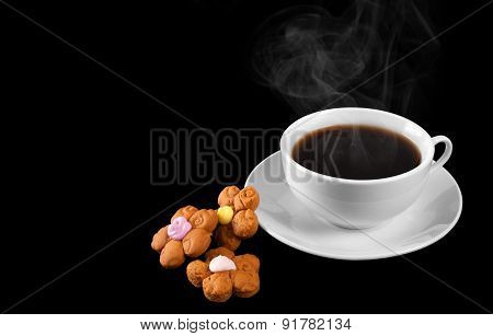 A Cup Of Hot Coffee And Cookies Isolated On A Black Background. Steam