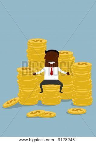 Black businessman sitting on golden coins stacks