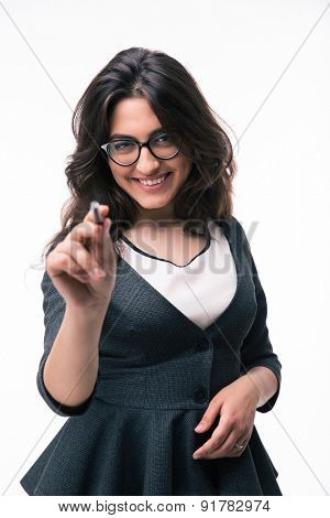 Happy businesswoman in glasses pointing on camera with pen isolated on a white background