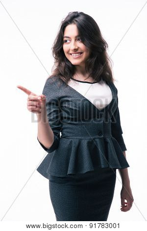 Smiling businesswoman pointing finger away isolated on a white background