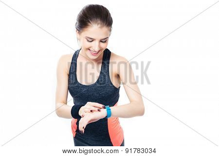 Happy sporty woman using smartwatch isolated on a white background