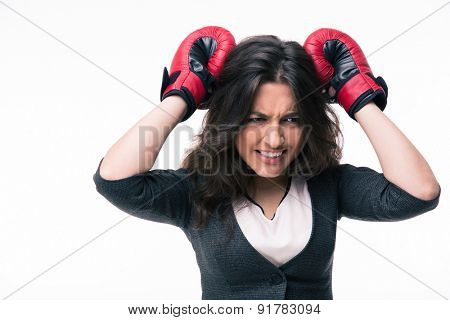 Loser businesswoman with boxing gloves isolated on a white background