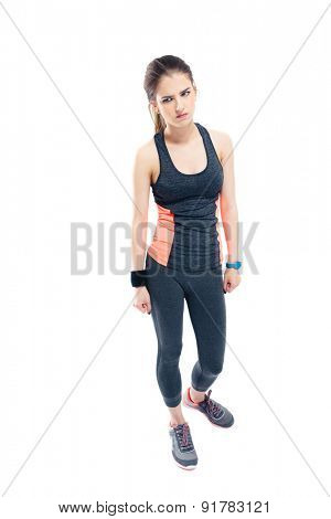 Full length portrait of a pensive sporty woman standing isolated on a white background