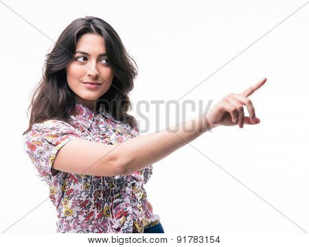 Cute woman pointing finger away isolated on a white background