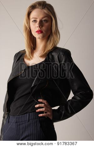 young cute blond girl in black leather jacket