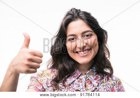 Happy young woman showing thumb up isolated on a white background. Looking at camera