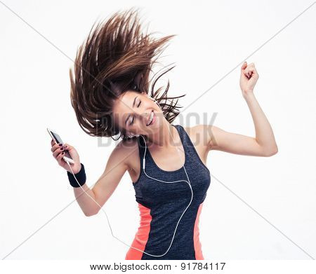 Beautiful woman with headphones in dancing motion. Hair fly. Isolated on a white background