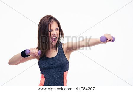 Angry woman workout with dumbbells isolated on a white background