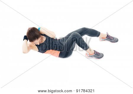 Woman doing exercises for abdominal muscles isolated on a white background