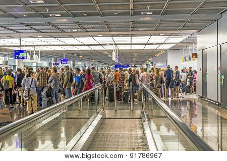 Passengers At The Departure Hall In The Airport