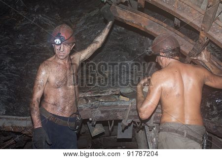 Novogrodovka, Ukraine - January, 18, 2013: Miners Construct Overlap At The Coal Face At A Depth Of 8