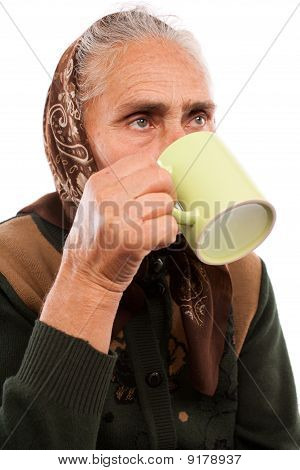 Senior Woman Drinking From A Cup