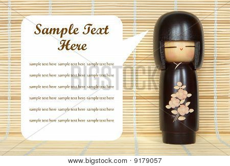 Japanese Doll On Bamboo Mat Background