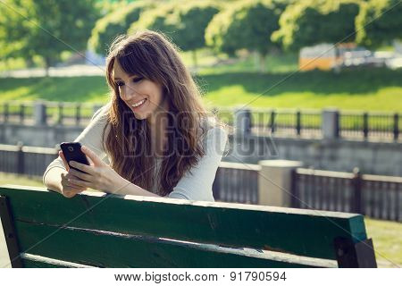 Young Pretty Woman Chatting Using Phone.