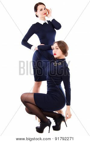 Two Young Women In A Short Dark Blue Dress