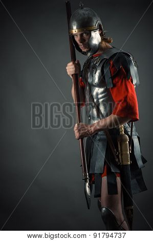 Roman soldier in armor with a spear in hand
