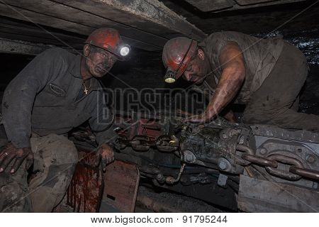 Donetsk, Ukraine - August 16, 2013: Miners Near The Coal Mining Shearer
