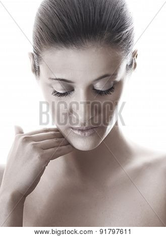 Close-up Above Shot Of A Woman With Closed Eyes Isolated On White Background - Studio Shot