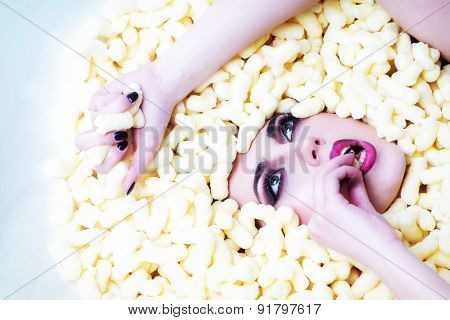 Beautiful Girl In Corn Sticks Heap