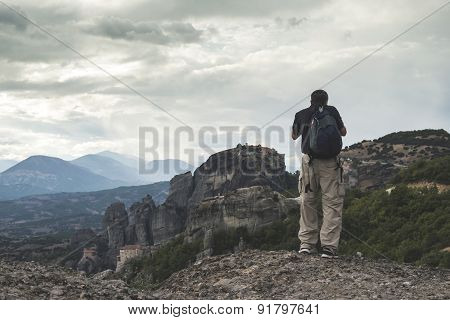 Man Taking Pictures In Meteora In Greece