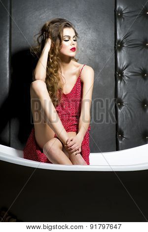 Beautiful Young Attractive Girl Sitting On Bath