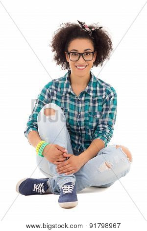 Happy Beautiful African American Teenage Girl Sitting Isolated On White