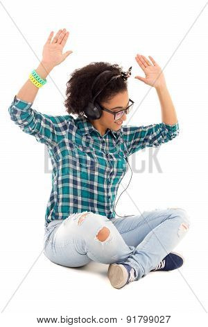 Happy African American Teenage Girl Sitting And Listening Music Isolated On White