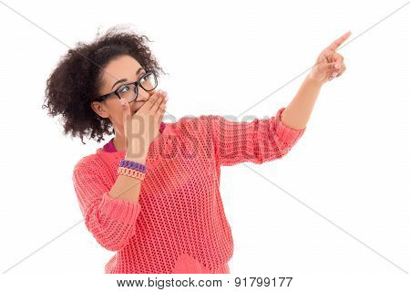 Gossip Concept - Pretty African American Teenage Girl In Pink Pointing At Something Isolated On Whit