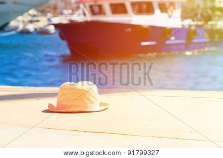 hat on vacation in summer coast