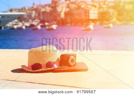 hat, glasses, camera and touch pad in summer Malta