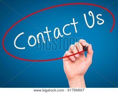 Man Hand writing Contact Us with marker on transparent wipe board.