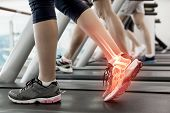 stock photo of treadmill  - Digital composite of Highlighted ankle of woman on treadmill - JPG