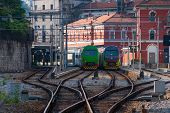 picture of passenger train  - Two passenger trains at small station in Switzerland - JPG