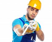 stock photo of meter  - Close up builder in a helmet  - JPG
