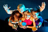foto of night-club  - Portrait of happy young people toasting in the nightclub - JPG