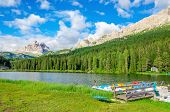 stock photo of pier a lake  - View on peaceful lake with padal boat pier and Tre Cime in background from Misurina village - JPG