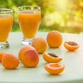 stock photo of apricot  - Apricot on table and freshly prepared juice of apricot