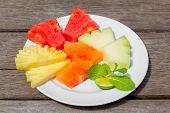 foto of papaya fruit  - Delicious breakfast of fresh fruit on a plate  - JPG