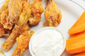 foto of chicken wings  - A dish of chicken hot wings and carrots with dipping sauce - JPG