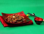 stock photo of stir fry  - Vietnamese beef stir fry served on a green background - JPG