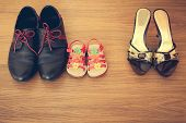 stock photo of mans-best-friend  - Three pairs of shoes - JPG