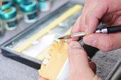 stock photo of dental impression  - dental technician working on false teeth - JPG