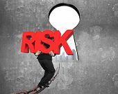 picture of keyhole  - Man carrying big red RISK 3D word walking on old iron chain toward keyhole door with urban scene view and gray concrete wall background - JPG