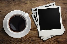 picture of polaroid  - coffee cup and polaroid photo frames on table - JPG